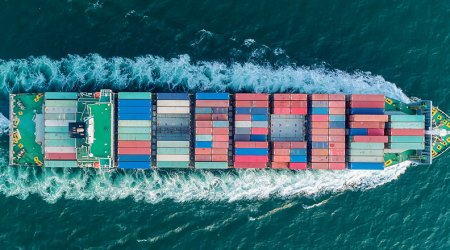 Aerial top view container ship full speed for logistics , import export, shipping or transportation.