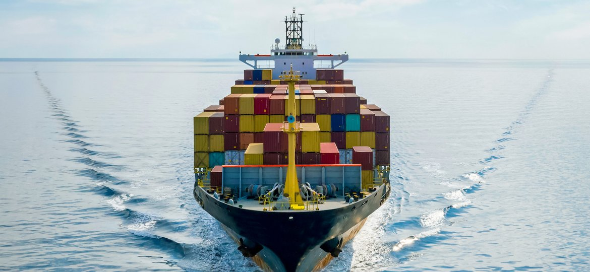 Aerial,Front,View,Of,A,Loaded,Container,Cargo,Vessel,Traveling